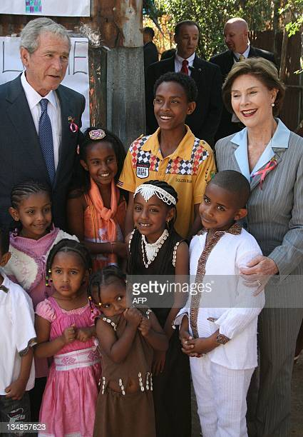 Former US President George W Bush with his wife former firstlady Barbara [R] visit a USfunded hospital treating people with HIV/AIDS in Addis Ababa...