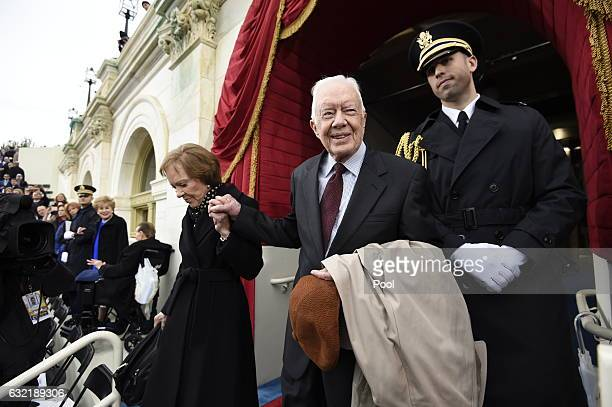 Former US President Jimmy Carter and First Lady Rosalynn Carter arrive for the Presidential Inauguration of Donald Trump at the US Capitol on January...