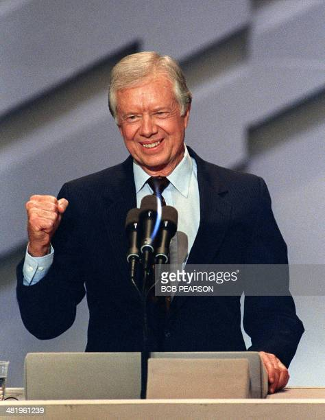 Former US President Jimmy Carter delivers the last speech at the first session of the 1988 Democratic National Convention 18 July 1988 in Atlanta...