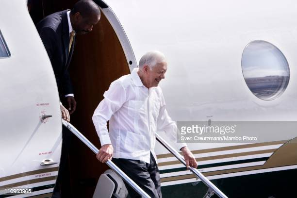 Former US President Jimmy Carter gets off the plane upon arrival at the Jose Marti airport for a three day visit on March 28 2011 in Havana Cuba...