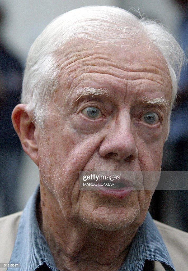 Former US President <a gi-track='captionPersonalityLinkClicked' href=/galleries/search?phrase=Jimmy+Carter+-+US+President&family=editorial&specificpeople=93589 ng-click='$event.stopPropagation()'>Jimmy Carter</a> grimace 02 December 2004 while listening to questions of an unseen journalist before beginning his polling station observation visit in Maputo, Mozambique. Mozambique's long-time President Joaquim Chissano expressed surprise Thursday at the abysmal turn-out in elections to choose his successor, and blamed the poor showing on widespread illiteracy and ignorance of political systems. AFP PHOTO/MARCO LONGARI