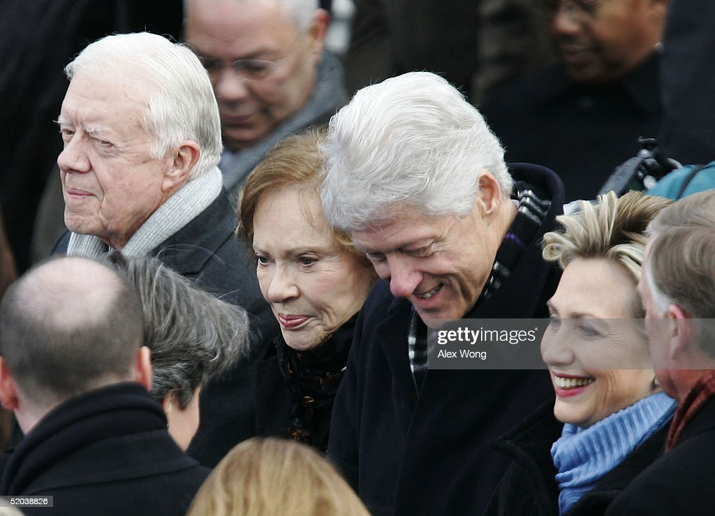 Former U.S. President <a gi-track='captionPersonalityLinkClicked' href=/galleries/search?phrase=Jimmy+Carter+-+US+President&family=editorial&specificpeople=93589 ng-click='$event.stopPropagation()'>Jimmy Carter</a>, his wife Rosalyn Carter, former U.S. President <a gi-track='captionPersonalityLinkClicked' href=/galleries/search?phrase=Bill+Clinton&family=editorial&specificpeople=67203 ng-click='$event.stopPropagation()'>Bill Clinton</a> and his wife, U.S. Senator Hillary Rodham Clinton (D-NY), stand together on the inaugural platform before the start of the swearing in ceremony for U.S. President George W. Bush January 20, 2005 in Washington, DC. President Bush will take his second oath of office January 20.