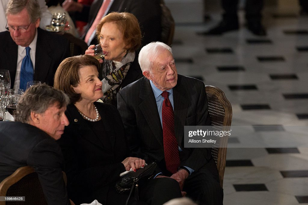 Former U.S. President <a gi-track='captionPersonalityLinkClicked' href=/galleries/search?phrase=Jimmy+Carter+-+President&family=editorial&specificpeople=93589 ng-click='$event.stopPropagation()'>Jimmy Carter</a>, his wife <a gi-track='captionPersonalityLinkClicked' href=/galleries/search?phrase=Rosalynn+Carter&family=editorial&specificpeople=94018 ng-click='$event.stopPropagation()'>Rosalynn Carter</a> (Rear) and U.S. Sen. <a gi-track='captionPersonalityLinkClicked' href=/galleries/search?phrase=Dianne+Feinstein&family=editorial&specificpeople=214078 ng-click='$event.stopPropagation()'>Dianne Feinstein</a> (C) listen during the Inaugural Luncheon in Statuary Hall on inauguration day at the U.S. Capitol building January 21, 2013 in Washington D.C. U.S. President Barack Obama was ceremonially sworn in for his second term today.
