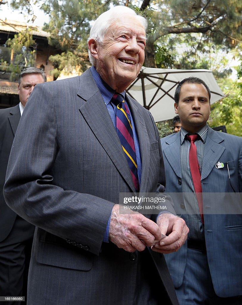 Former US President Jimmy Carter leaves after a press conference in Kathmandu on April 1, 2013. Carter is in Kathmandu on a four-day visit. AFP PHOTO/Prakash MATHEMA
