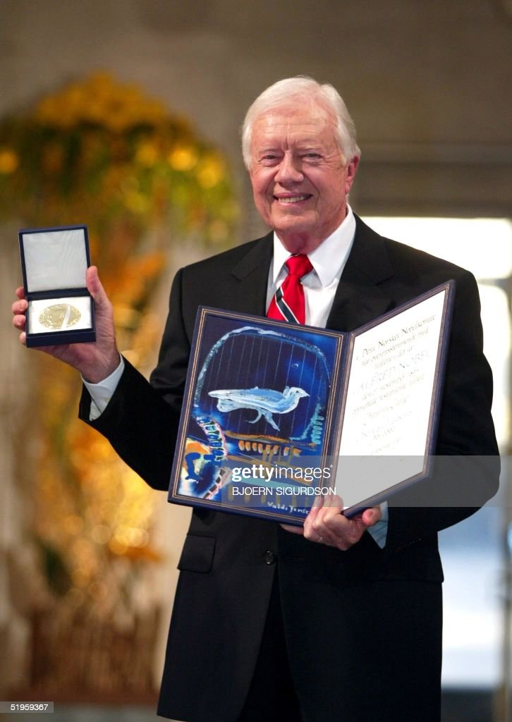 Former US president Jimmy Carter smiles after receiving the 2002 Nobel Peace Prize during a ceremony in the Oslo City Hall 10 December 2002