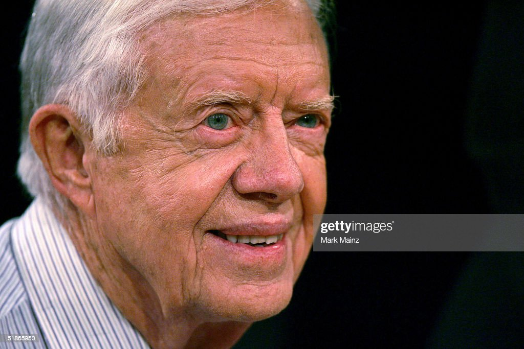 Former U.S. President <a gi-track='captionPersonalityLinkClicked' href=/galleries/search?phrase=Jimmy+Carter+-+US+President&family=editorial&specificpeople=93589 ng-click='$event.stopPropagation()'>Jimmy Carter</a> smiles as he attends an autograph session for his book 'Sharing Good Times' at Borders Books and Music December 15, 2004 in Westwood, California.