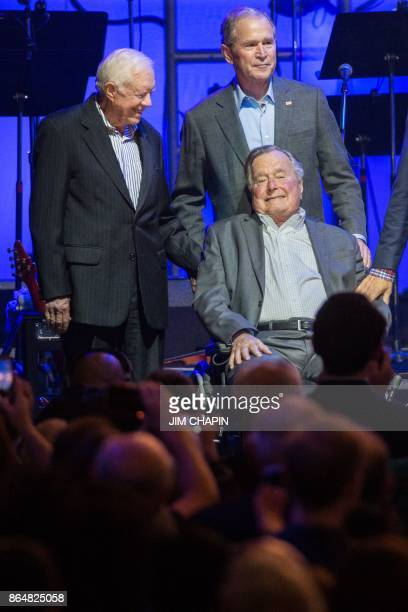 Former US President Jimmy Carter with President George W Bush and President George H W Bush attend the Hurricane Relief concert in College Station...
