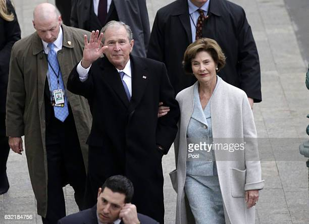 Former US President of the United States George W Bush and wife Laura Bush arrive near the east front steps of the Capitol Building before...