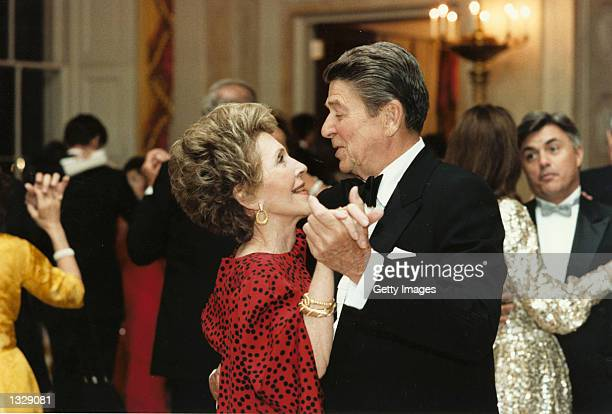 Former US President Ronald Reagan dances with former First Lady Nancy Reagan in this undated file photo The couple celebrated their 50th wedding...
