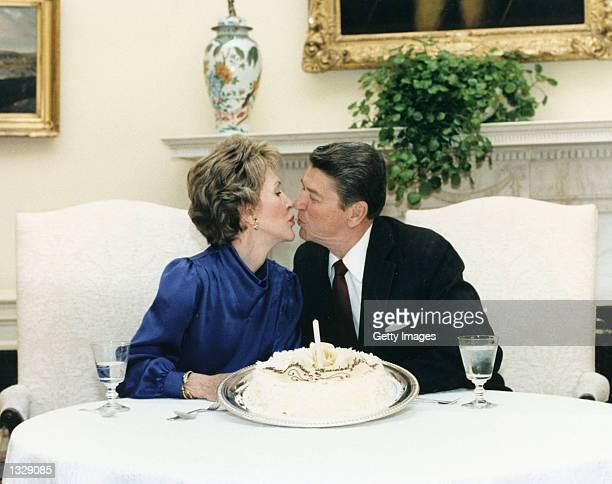 Former US President Ronald Reagan kisses former First Lady Nancy Reagan in this undated file photo The couple celebrated their 50th wedding...
