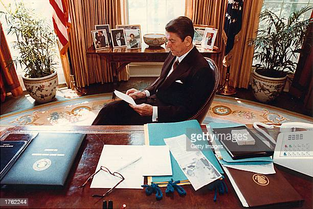 Former US President Ronald Reagan prepares a speech at his desk in the Oval Office for a Joint Session of Congress on April 28 1981 Reagan turns 92...