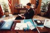Former US President Ronald Reagan prepares a speech at his desk in the Oval Office for a Joint Session of Congress on April 28 1981 Reagan turns 93...