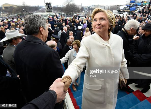 Former US presidential candidate Hillary Clinton leaves after the Presidential Inauguration at the US Capitol on January 20 2017 in Washington DC...