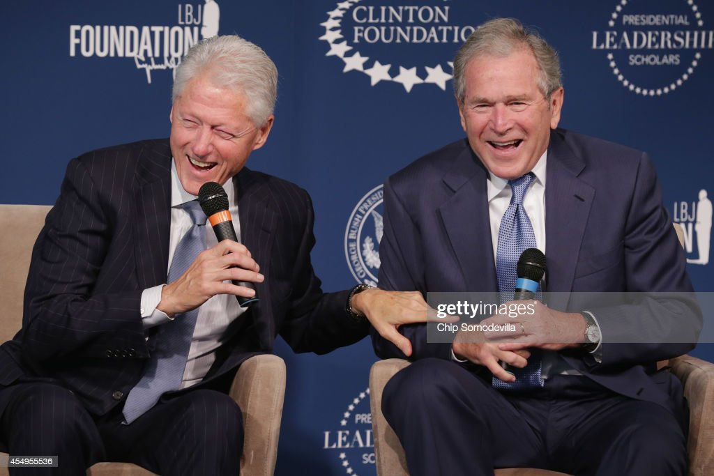 Former U.S. presidents Bill Clinton (L) and George W. Bush share a laugh during an event launching the Presidential Leadership Scholars program at the Newseum September 8, 2014 in Washington, DC. With the cooperation of the Clinton, Bush, Lyndon B. Johnson and George H. W. Bush presidential libraries and foundations, the new scholarship program will provide 'motivated leaders across all sectors an opportunity to study presidential leadership and decision making and learn from key administration officials, practitioners and leading academics.'