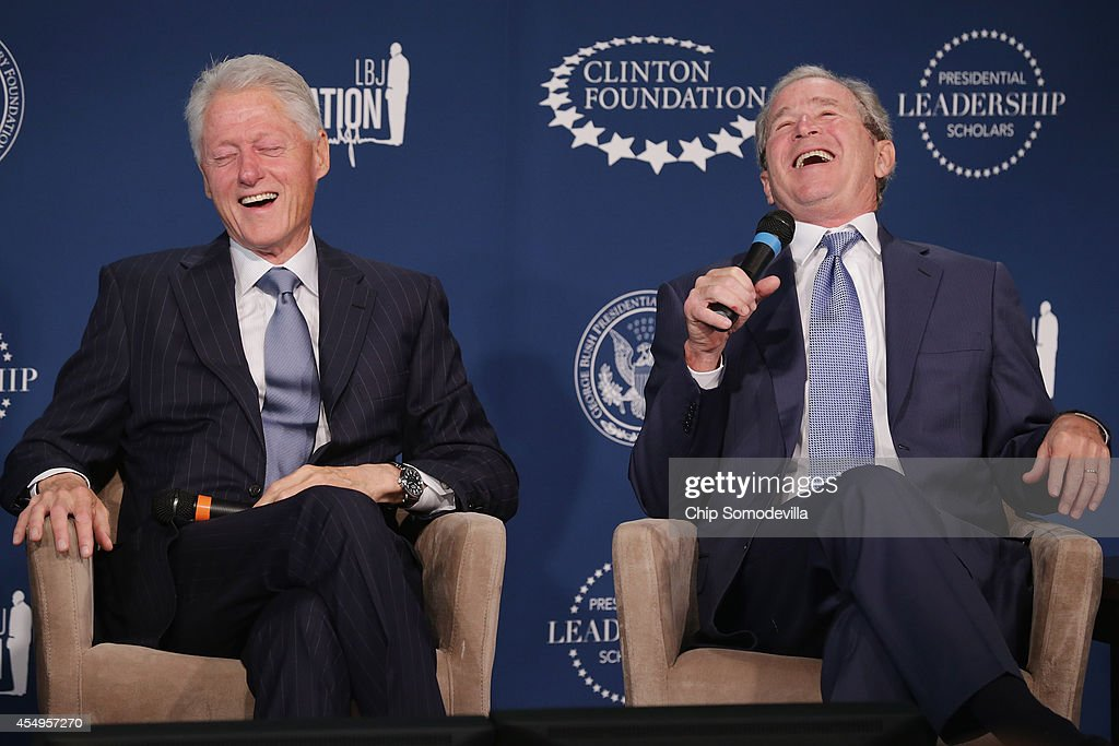 Former US presidents Bill Clinton and George W Bush share a laugh during an event launching the Presidential Leadership Scholars program at the...
