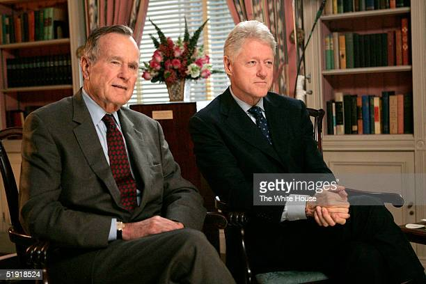 Former US presidents George H W Bush and Bill Clinton film a public service announcement in the White House Library encouraging Americans to make...