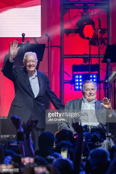 Former US Presidents Jimmy Carter and George HW Bush attend the Hurricane Relief concert in College Station Texas on October 21 2017 / AFP PHOTO /...