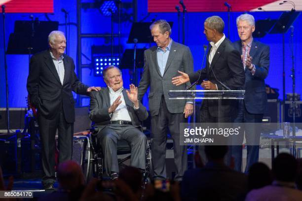 Former US Presidents Jimmy Carter George H W Bush Barack Obama George W Bush and Bill Clinton attend the Hurricane Relief concert in College Station...