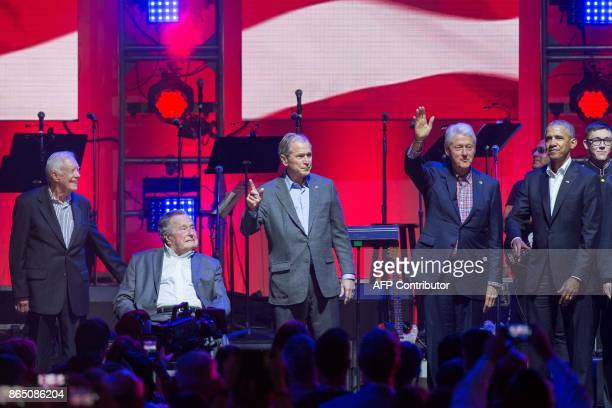 Former US Presidents Jimmy Carter George H W Bush George W Bush Bill Clinton and Barack Obama attend the Hurricane Relief concert in College Station...