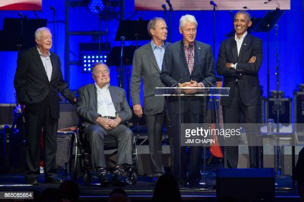 Former US Presidents Jimmy Carter George H W BushGeorge W Bush Bill Clinton and Barack Obama attend the Hurricane Relief concert in College Station...