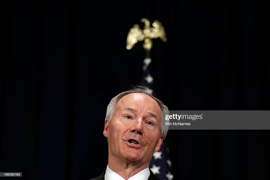 Former U.S. Rep. <a gi-track='captionPersonalityLinkClicked' href=/galleries/search?phrase=Asa+Hutchinson&family=editorial&specificpeople=216591 ng-click='$event.stopPropagation()'>Asa Hutchinson</a> announces the recommendations of the NRA backed National School Shield Program regarding school security during a press conference April 2, 2013 at the National Press Club in Washington, DC. Among other findings, the report recommended training and placing armed personnel in public schools following the Sandy Hook Elementary School shooting.