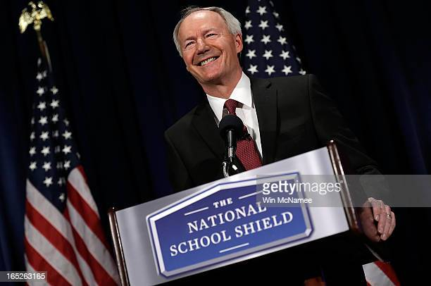 Former US Rep Asa Hutchinson announces the recommendations of the NRA backed National School Shield Program regarding school security during a press...