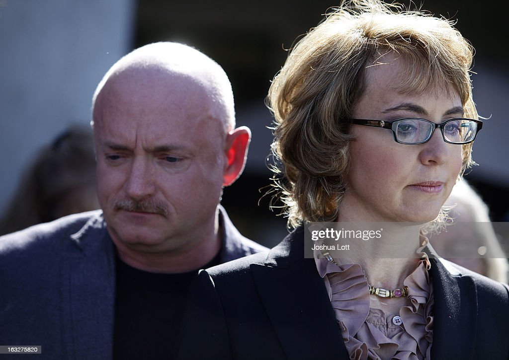 Former U.S. Rep. Gabby Giffords and her husband Mark Kelly attend a news conference outside Safeway grocery store where they asked Congress to provide stricter gun control in the United States on March 6, 2013 in Tucson, Arizona. Giffords and Kelly were joined by survivors of the Tucson shooting that took place there two years ago when six people were killed and Giffords herself was shot in the head.