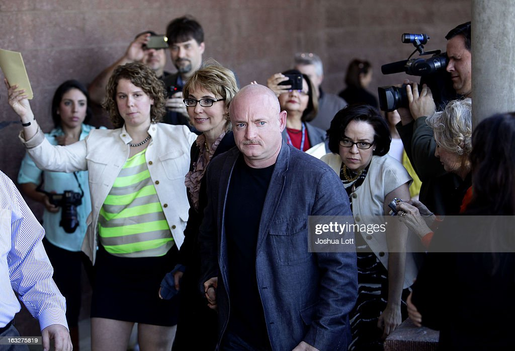 Former U.S. Rep. Gabby Giffords and her husband Mark Kelly leave a news conference outside Safeway grocery store where they asked Congress to provide stricter gun control in the United States on March 6, 2013 in Tucson, Arizona. Giffords and Kelly were joined by survivors of the Tucson shooting that took place there two years ago when six people were killed and Giffords herself was shot in the head.