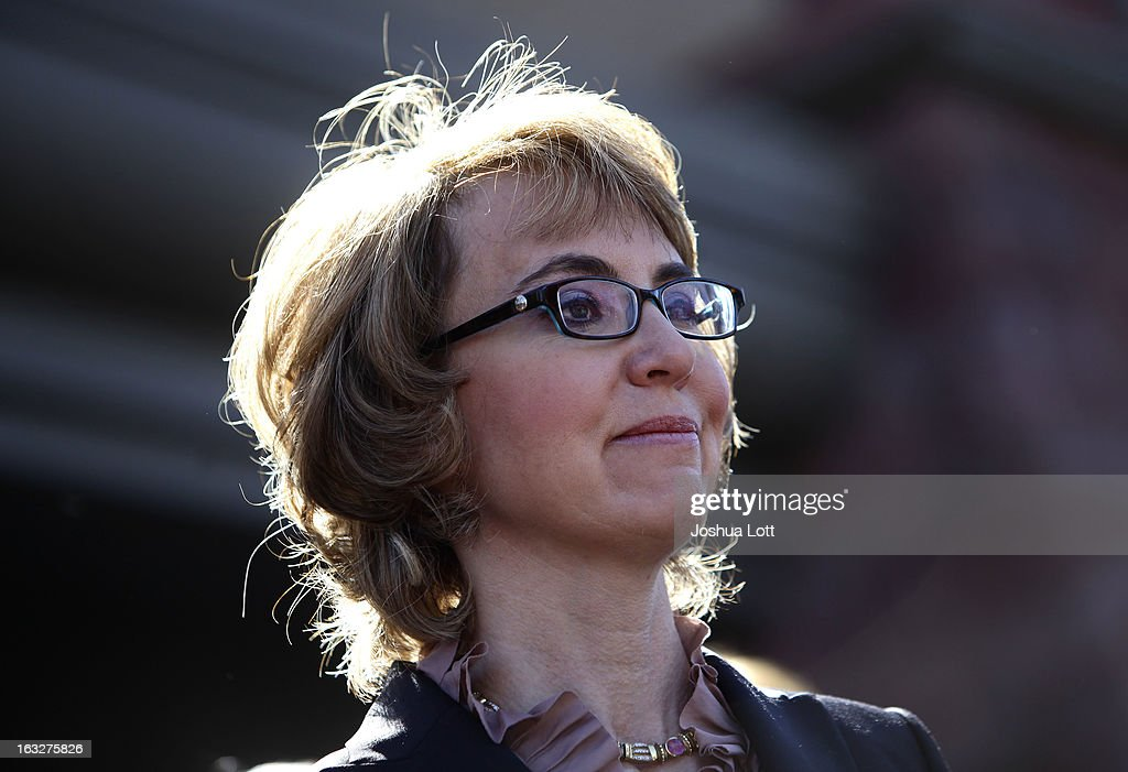 Former U.S. Rep. Gabby Giffords attends a news conference outside Safeway grocery store where they asked Congress to provide stricter gun control in the United States on March 6, 2013 in Tucson, Arizona. Giffords and Kelly were joined by survivors of the Tucson shooting that took place there two years ago when six people were killed and Giffords herself was shot in the head.