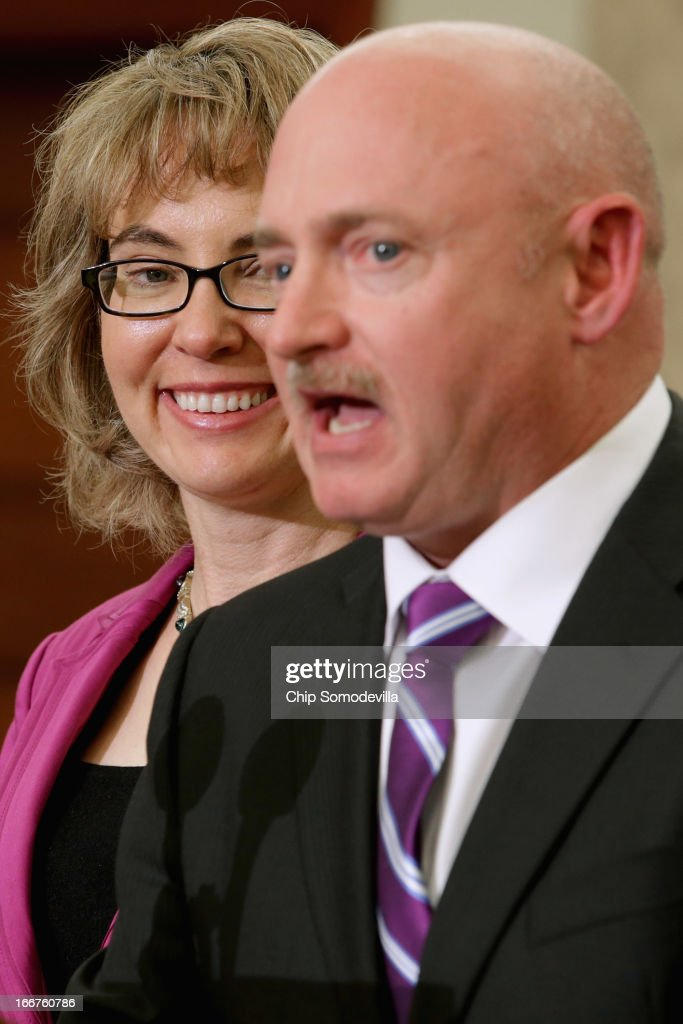 Former U.S. Rep. Gabrielle Giffords (D-AZ) (L) and her husband former astronaut Mark Kelly speak during the dedication ceremony of the Gabriel Zimmerman Meeting Room in the U.S. Capitol Visitors Center April 16, 2013 in Washington, DC. A member of Giffords' Congressional staff, Gabriel Zimmerman was murdered during a shooting spree January 8, 2011 that left six dead and 13 injured, including Giffords.