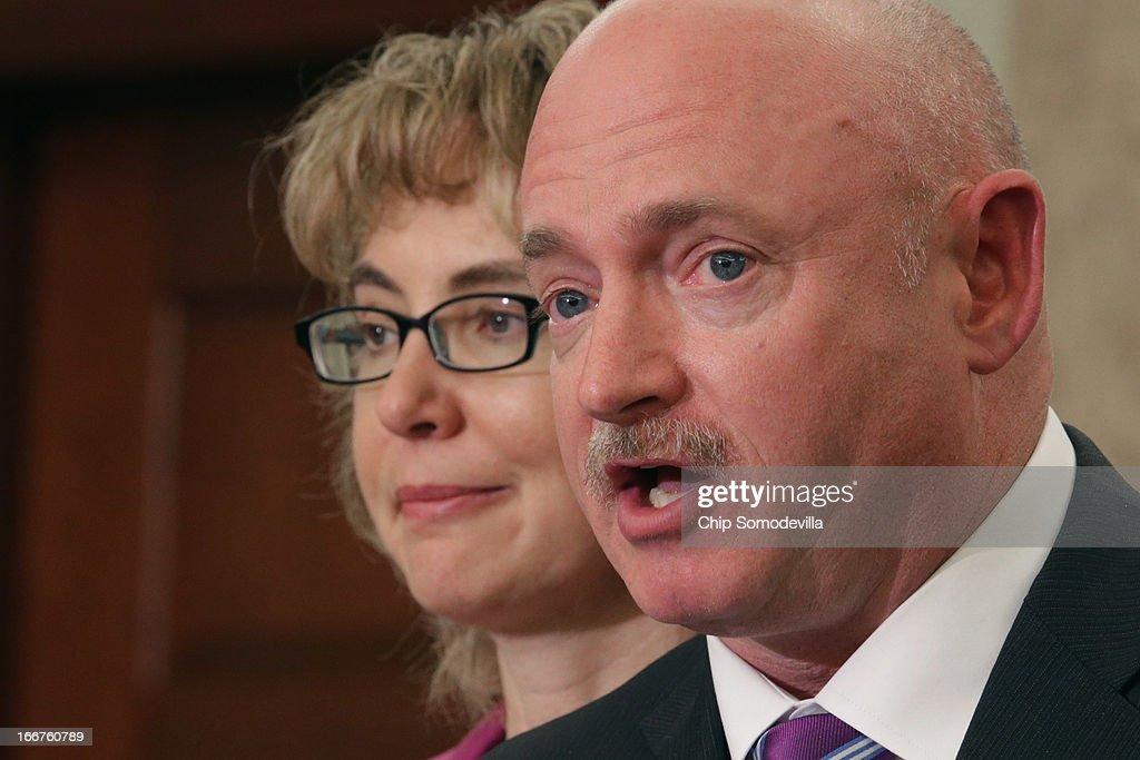 Former U.S. Rep. <a gi-track='captionPersonalityLinkClicked' href=/galleries/search?phrase=Gabrielle+Giffords&family=editorial&specificpeople=6961081 ng-click='$event.stopPropagation()'>Gabrielle Giffords</a> (D-AZ) (L) and her husband former astronaut <a gi-track='captionPersonalityLinkClicked' href=/galleries/search?phrase=Mark+Kelly+-+Astronaut+and+Gun+Control+Advocate&family=editorial&specificpeople=566699 ng-click='$event.stopPropagation()'>Mark Kelly</a> speak during the dedication ceremony of the Gabriel Zimmerman Meeting Room in the U.S. Capitol Visitors Center April 16, 2013 in Washington, DC. A member of Giffords' Congressional staff, Gabriel Zimmerman was murdered during a shooting spree January 8, 2011 that left six dead and 13 injured, including Giffords.