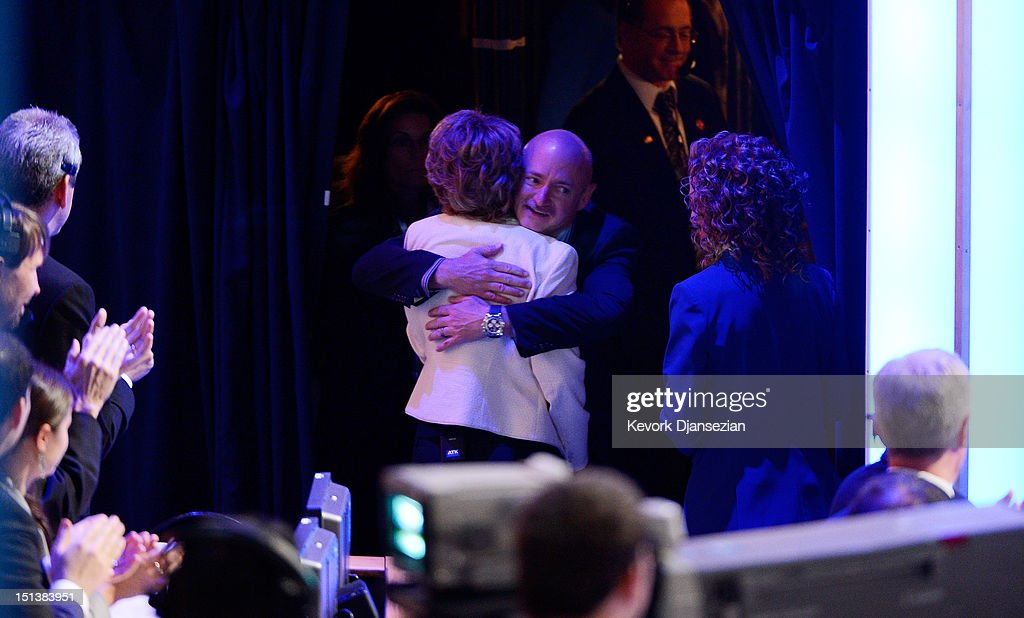 Former U.S. Rep. Gabrielle Giffords (D-NV) hugs her husband former NASA astronaut Mark Kelly stage during the final day of the Democratic National Convention at Time Warner Cable Arena on September 6, 2012 in Charlotte, North Carolina. The DNC, which concludes today, nominated U.S. President Barack Obama as the Democratic presidential candidate.