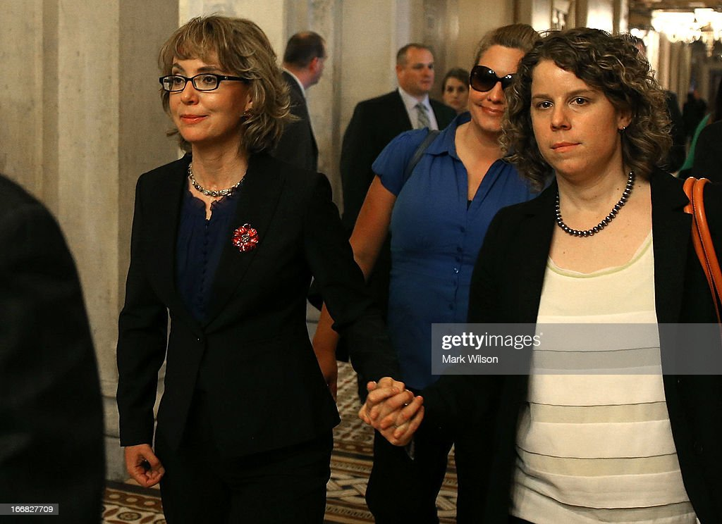 Former U.S. Rep. Gabrielle Giffords (D-AZ) (L) leaves the Capitol after a vote on the Senate floor April 17, 2013 on Capitol Hill in Washington, DC. The Senate rejected a proposal by Sens. Joe Manchin (D-WV) and Pat Toomey (R-PA) to expand background checks on firearms purchases and to close the so-called gun-show loophole.