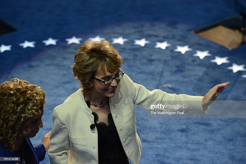 Former U.S. Rep. Gabrielle Giffords (D-Az.), right, on stage with Democratic National Committee Chair, U.S. Rep. Debbie Wasserman Schultz (D-Fl.) (L) during the final day of the 2012 Democratic National Convention at the Time Warner Center on September 6, 2012 in Charlotte, North Carolina.