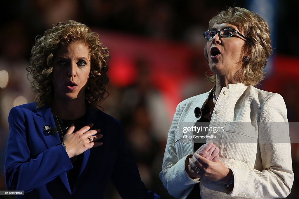 Former U.S. Rep. <a gi-track='captionPersonalityLinkClicked' href=/galleries/search?phrase=Gabrielle+Giffords&family=editorial&specificpeople=6961081 ng-click='$event.stopPropagation()'>Gabrielle Giffords</a> (D-NV) says the Pledge of Allegiance on stage with Democratic National Committee Chair, U.S. Rep. Debbie Wasserman Schultz (D-FL) (L) during the final day of the Democratic National Convention at Time Warner Cable Arena on September 6, 2012 in Charlotte, North Carolina. The DNC, which concludes today, nominated U.S. President Barack Obama as the Democratic presidential candidate.