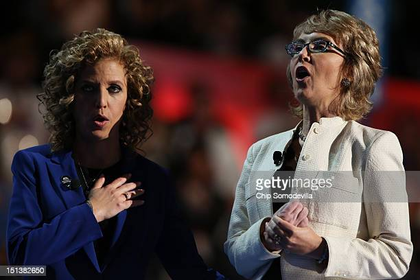 Former US Rep Gabrielle Giffords says the Pledge of Allegiance on stage with Democratic National Committee Chair US Rep Debbie Wasserman Schultz...