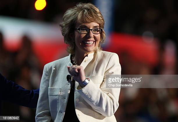 Former US Rep Gabrielle Giffords stands on stage during the final day of the Democratic National Convention at Time Warner Cable Arena on September 6...