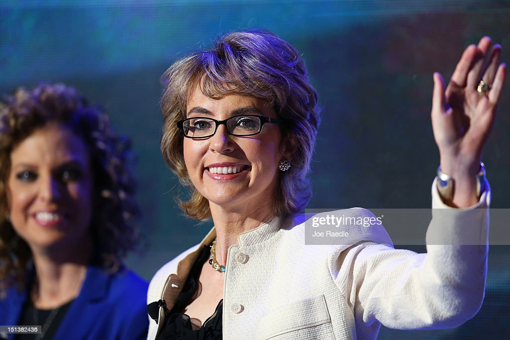 Former U.S. Rep. <a gi-track='captionPersonalityLinkClicked' href=/galleries/search?phrase=Gabrielle+Giffords&family=editorial&specificpeople=6961081 ng-click='$event.stopPropagation()'>Gabrielle Giffords</a> (D-NV) walks on stage with Democratic National Committee Chair, U.S. Rep. Debbie Wasserman Schultz (D-FL) during the final day of the Democratic National Convention at Time Warner Cable Arena on September 6, 2012 in Charlotte, North Carolina. The DNC, which concludes today, nominated U.S. President Barack Obama as the Democratic presidential candidate.
