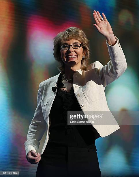 Former US Rep Gabrielle Giffords waves on stage during the final day of the Democratic National Convention at Time Warner Cable Arena on September 6...