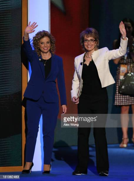 Former US Rep Gabrielle Giffords waves on stage with Democratic National Committee Chair US Rep Debbie Wasserman Schultz during the final day of the...