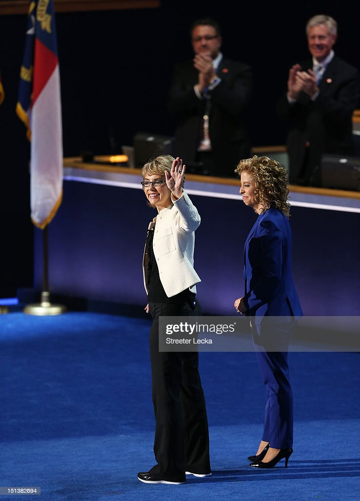 Former U.S. Rep. Gabrielle Giffords (D-NV) waves on stage with Democratic National Committee Chair, U.S. Rep. Debbie Wasserman Schultz (D-FL) during the final day of the Democratic National Convention at Time Warner Cable Arena on September 6, 2012 in Charlotte, North Carolina. The DNC, which concludes today, nominated U.S. President Barack Obama as the Democratic presidential candidate.