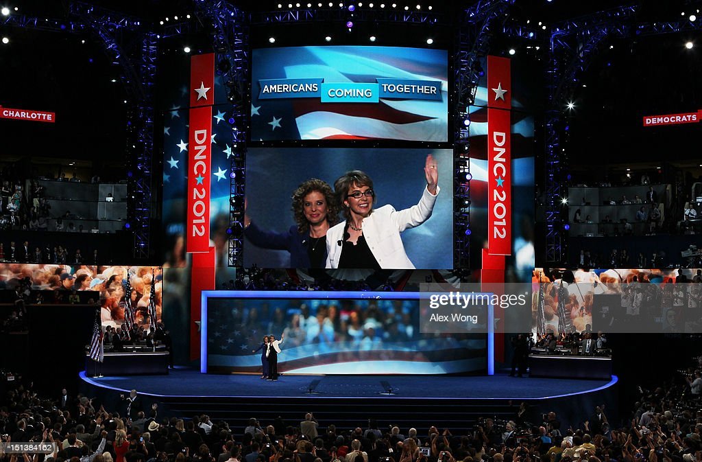 Former U.S. Rep. Gabrielle Giffords (D-NV) waves on stage with Democratic National Committee Chair, U.S. Rep. Debbie Wasserman Schultz (D-FL) (L) during the final day of the Democratic National Convention at Time Warner Cable Arena on September 6, 2012 in Charlotte, North Carolina. The DNC, which concludes today, nominated U.S. President Barack Obama as the Democratic presidential candidate.