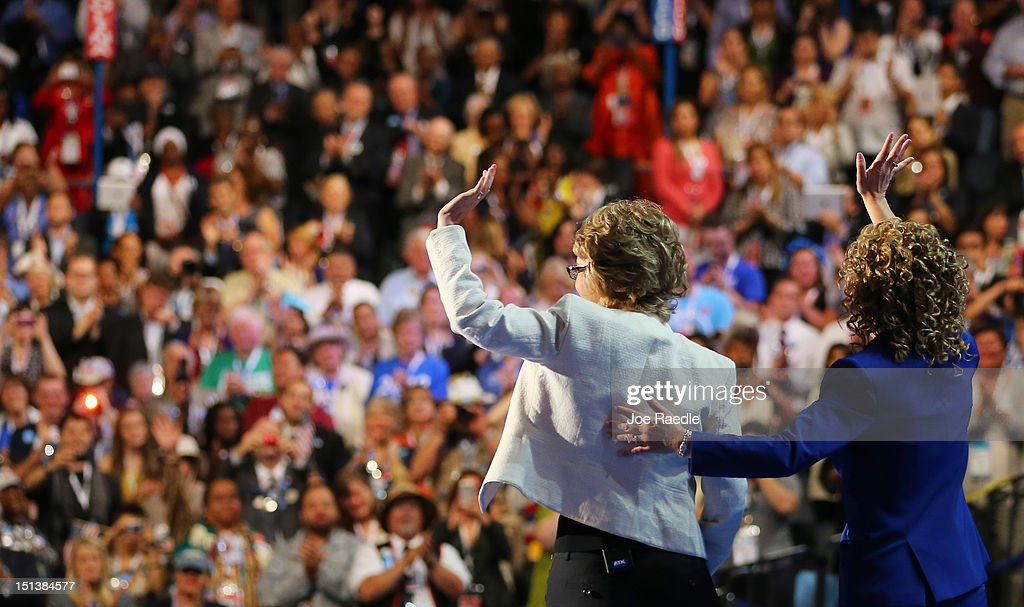 Former U.S. Rep. Gabrielle Giffords (D-NV) waves on stage with Democratic National Committee Chair, U.S. Rep. Debbie Wasserman Schultz (D-FL) (R) during the final day of the Democratic National Convention at Time Warner Cable Arena on September 6, 2012 in Charlotte, North Carolina. The DNC, which concludes today, nominated U.S. President Barack Obama as the Democratic presidential candidate.