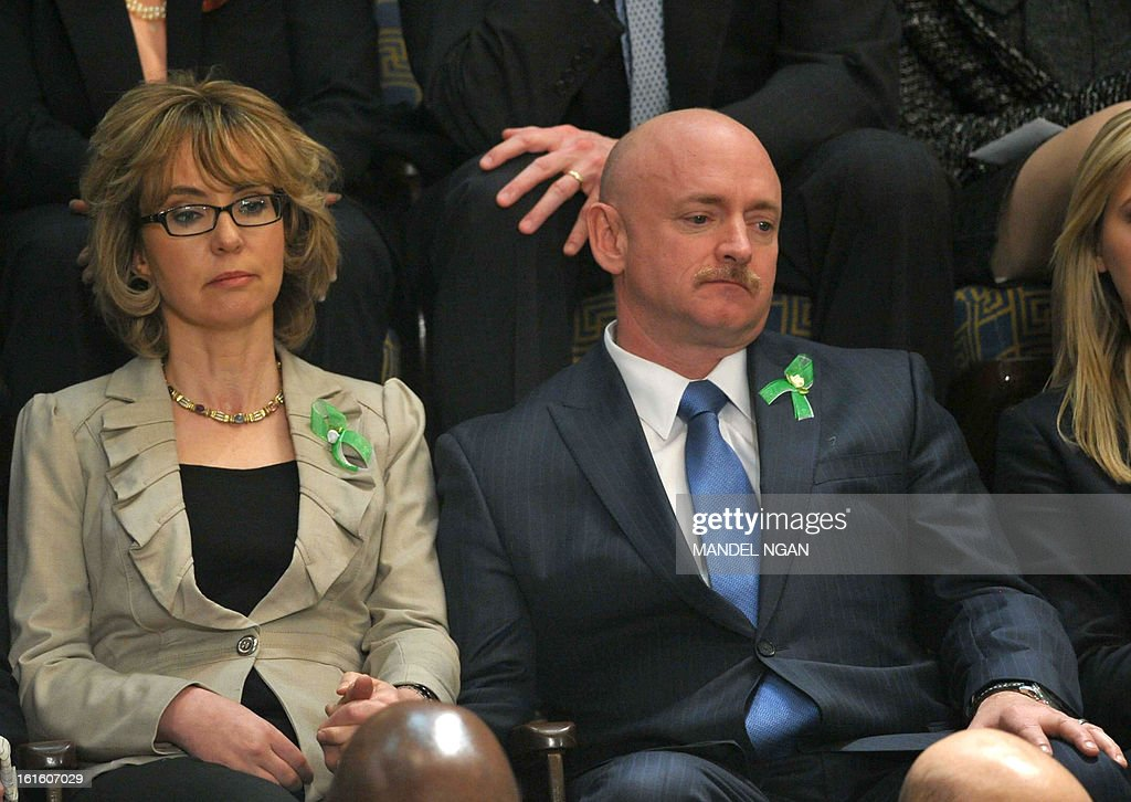 Former US Representative Gabrielle Giffords and her husband former astronaut Mark Kelly listen to US President Barack Obama deliver his State of the Union address before a joint session of Congress on February 12, 2013 at the US Capitol in Washington. AFP PHOTO/Mandel NGAN