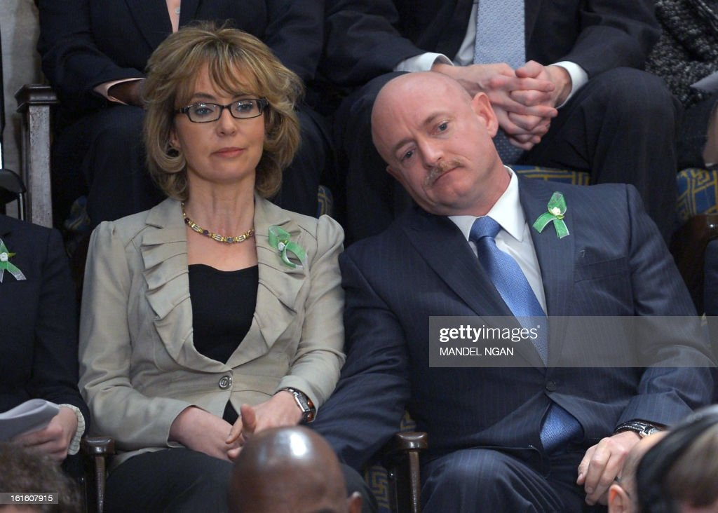 Former US Representative Gabrielle Giffords and her husband former astronaut Mark Kelly listen to US President Barack Obama deliver his State of the Union address before a joint session of Congress on February 12, 2013 at the Capitol in Washington. AFP PHOTO/Mandel NGAN
