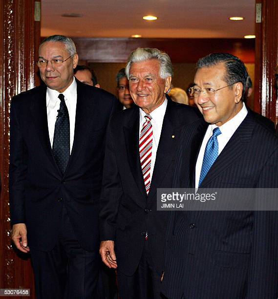 Former US Secretary of State Colin Powell and former prime ministers Bob Hawke of Australia and Mahathir Mohamad of Malaysia arrive at a global...