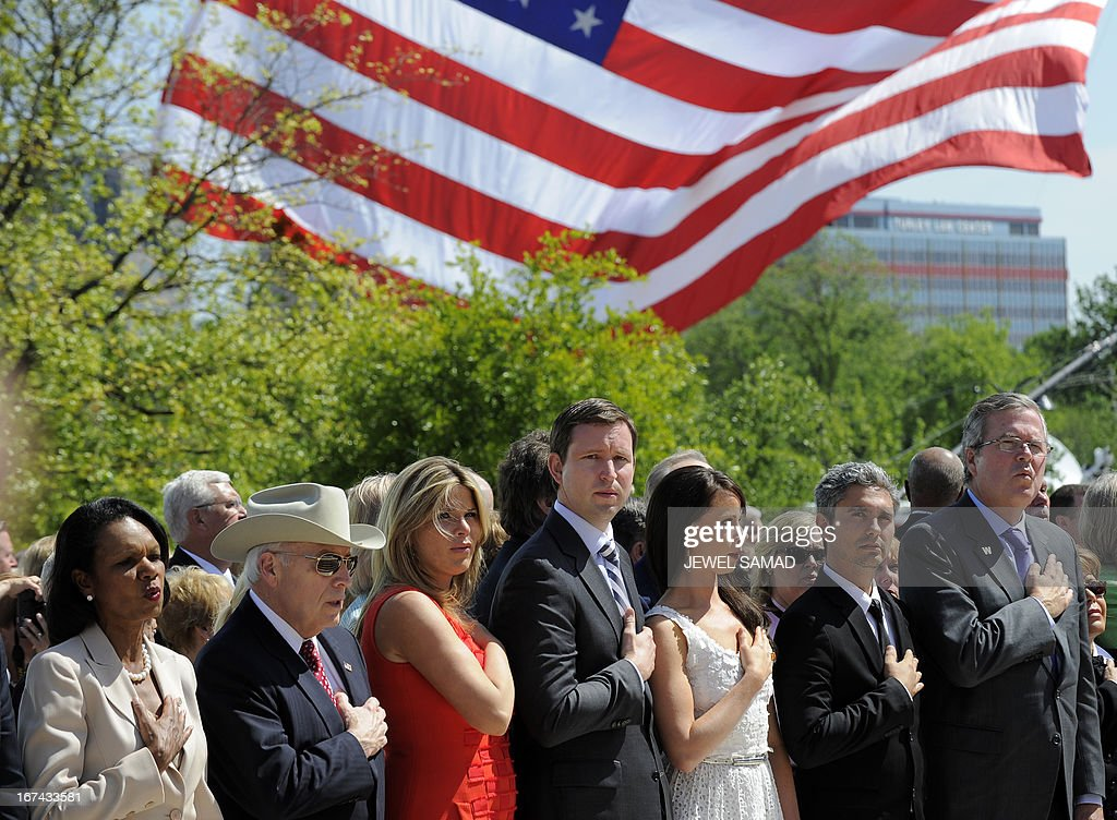 Former US Secretary of State Condoleezza Rice, Former US Vice President Dick Cheney, Jenna Bush Hager, her husband Henry Hager, Barbara Bush, John Ellis Bush, Jr. and his father former Florida Governor Jeb Bush sing the national anthem during the George W. Bush Presidential Center dedication ceremony in Dallas, Texas, on April 25, 2013. AFP PHOTO/Jewel Samad