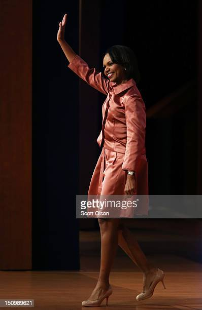 Former US Secretary of State Condoleezza Rice waves as she takes the stage during the third day of the Republican National Convention at the Tampa...