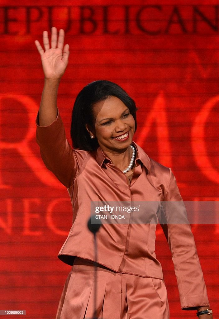 Former US Secretary of State Condoleezza Rice waves to the crowd at the Tampa Bay Times Forum in Tampa, Florida, on August 29, 2012 during the Republican National Convention (RNC). The RNC will culminate on August 30th with the formal nomination of Mitt Romney and Paul Ryan as the GOP presidential and vice-presidential candidates in the US presidential election. AFP PHOTO Stan HONDA