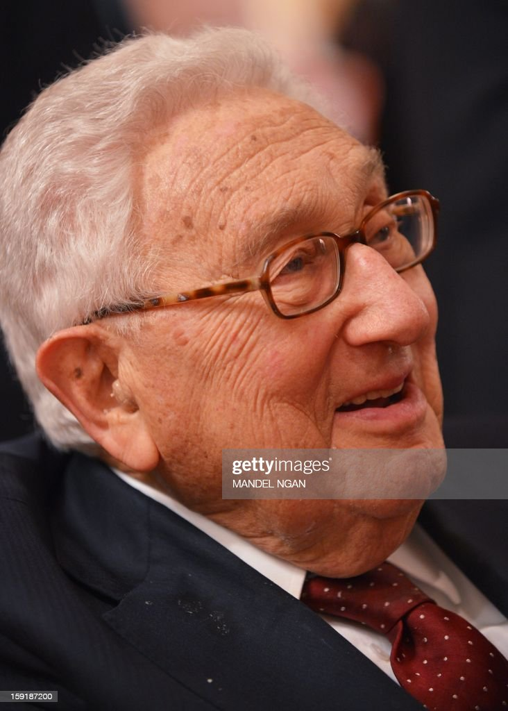 Former US secretary of state Henry Kissinger speaks to a guest during a reception celebrating the 100th birthday of former US president Richard Nixon on January 9, 2013 at a hotel in Washington, DC. AFP PHOTO/Mandel NGAN